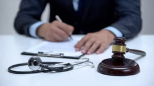 medical malpractice lawyer signing document